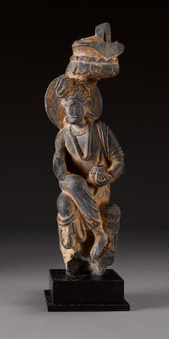 A schist figure of an attendant Gandhara, 2nd century