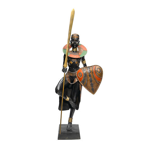 A patinated bronze figure of an African warrior