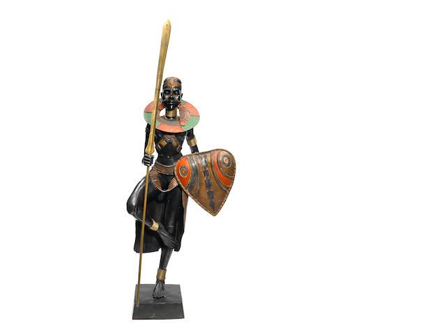A patinated bronze figure of an African warrior