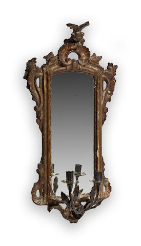 An Italian Rococo giltwood and iron two light girandole mirror third quarter 18th century