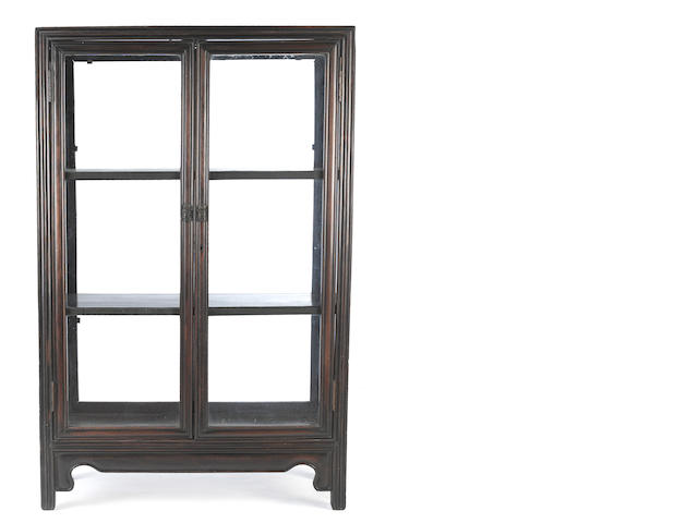 A hardwood and glazed display cabinet Republic period