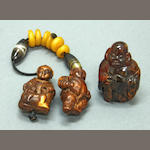 An amber and two burlwood figural toggles