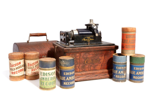 An Edison cylinder phonograph together with a quantity of cylinders