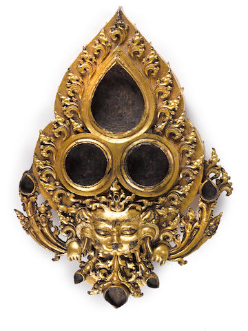 Tibetan gilt copper alloy plaque with Kirttimukha  Densatil, Tibet, 15th Century