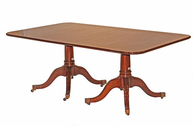 A George III style mahogany dining table Manufactured by Burton Ching