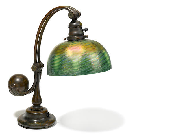 A Tiffany Studios Favrile glass and patinated bronze counter balance table lamp