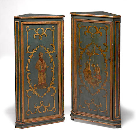 Two Continental Neoclassical style chinoiserie decorated painted corner cabinets<BR />fourth quarter 19th century