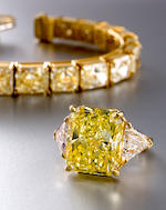 A fancy colored diamond and diamond ring, Bulgari