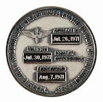 IRWIN'S FLOWN APOLLO 15 ROBBINS MEDALLION. ONE OF ONLY 127 CARRIED ON THE MISSION.  Flown Apollo 15 Robbins medallion made from sterling silver, 1¼ inches in diameter.