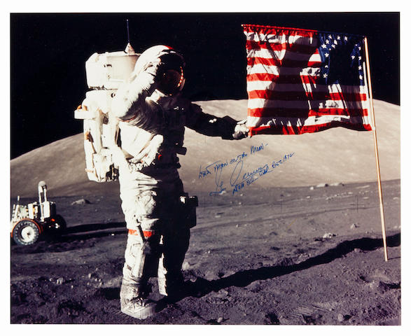 CERNAN SALUTES THE LAST STARS AND STRIPES. Large color photograph, 16 x 20 inches.