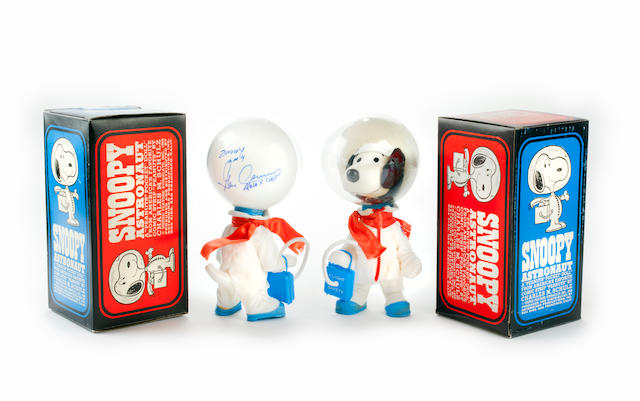 "SYMBOLS OF THE APOLLO X LM CREW—SIGNED. Two ""Snoopy"" astronaut dolls, produced in China by Determined Distributions of San Francisco for United Feature Syndicate, 1969."