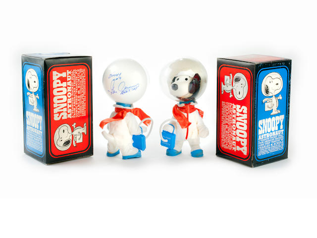 SYMBOLS OF THE APOLLO X LM CREW—SIGNED. Two Snoopy Astronaut dolls, produced in China by Determined Distributions of San Francisco for United Feature Syndicate, 1969.