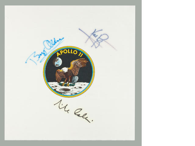 SIGNED BY THE ENTIRE APOLLO 11 CREW. Apollo 11 Beta cloth crew emblem, 3½ inches in diameter, printed on white Beta cloth 9 inches square.