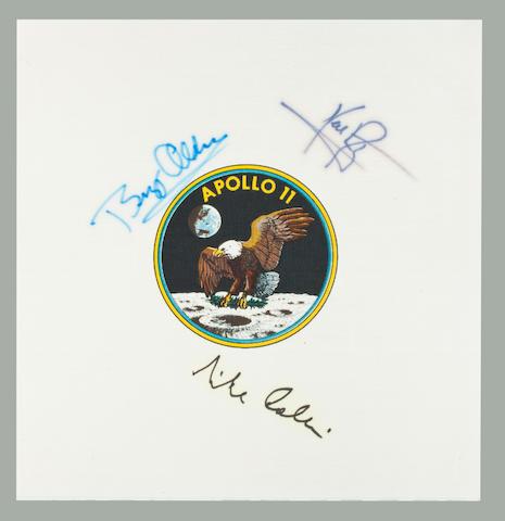 SIGNED BY THE ENTIRE APOLLO 11 CREW. Apollo 11 Beta cloth crew emblem, 3½ inches in diameter, printed on white Beta cloth 9 inches square.