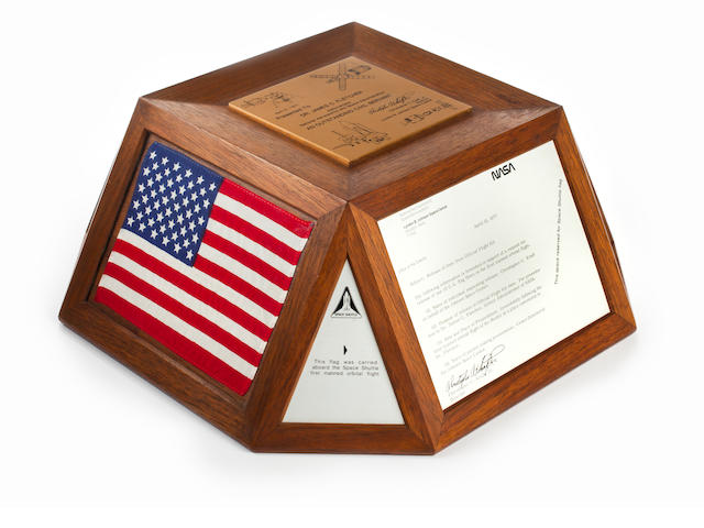 PRESENTED BY CHRIS KRAFT TO JAMES FLETCHER. Desktop presentation comprising three flown flags, each 4 x 6 inches, and accompanying plaques, mahogany, the flags behind lucite panels.