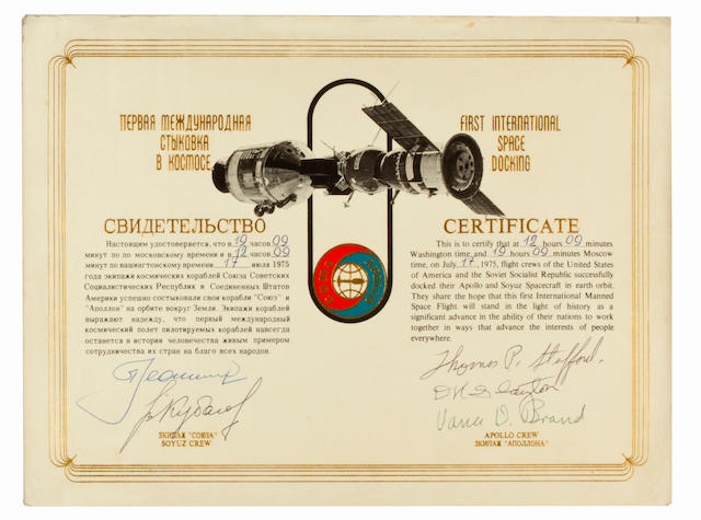 THE SPACE MAGNA CARTA. Printed certificate featuring an illustration of the linked Apollo and Soyuz spacecraft, with mission insignia below.