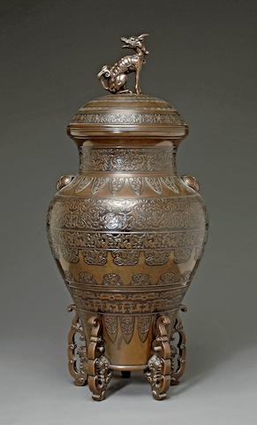 A large patinated bronze covered urn Taisho/Showa period