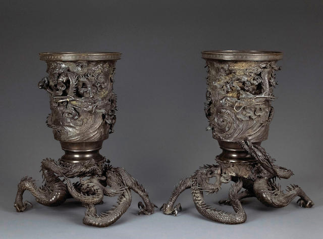 A pair of large two-section bronze urns with dragons Meiji period, late 19th century