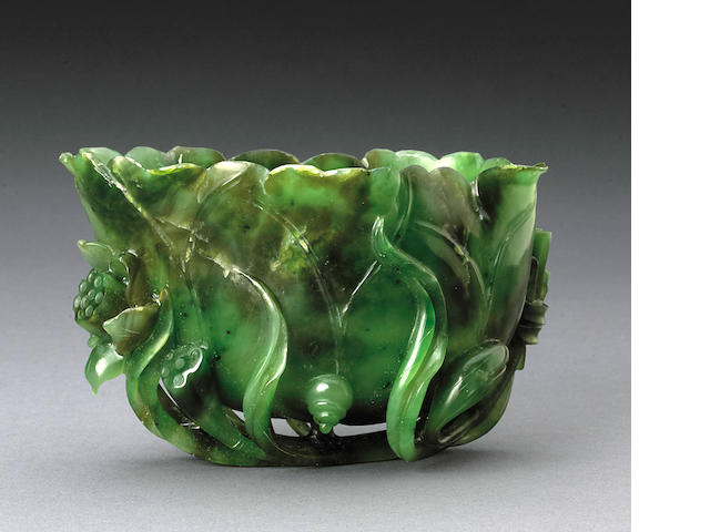 A spinach jade lotus-form libation vessel  Late Qing/Republic period