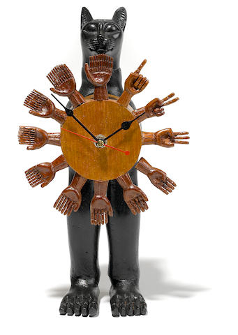 Pedro Friedeberg (Mexican, born 1937) Part-ebonized wood cat and hand table clock