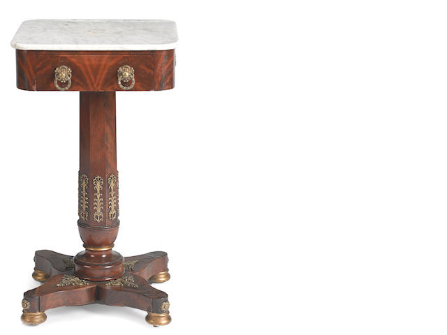 A Charles X gilt bronze mounted mahogany table a ouvrage<BR />first quarter 19th century