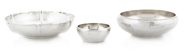An assembled group of three American hand wrought sterling silver Arts & Crafts graduated bowls first half 20th century