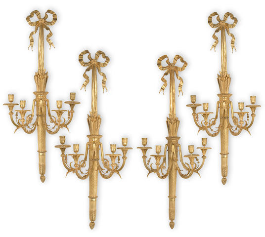 A set of four Louis XVI style gilt bronze four light bras de lumière<BR />20th century