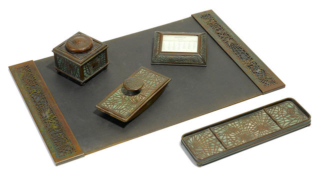 A Tiffany Studios patinated bronze five-piece Pine Needle desk set 1899-1918