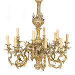 A Rococo style gilt bronze twelve light chandelier<BR />late 19th/early 20th century