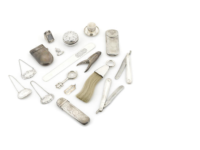 An assembled International group of Gentleman's  sterling silver  accessories by various makers,  19th / 20th century