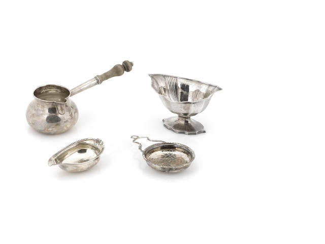 A group of English silver hollowware - pap boat, strainer, sugar bowl (lacking liner)
