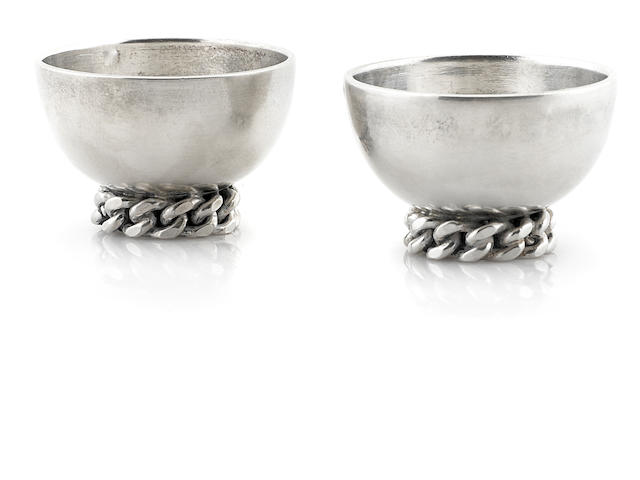 A pair of Jean Despres silverplate egg cups