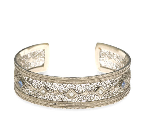 A diamond, sapphire and fourteen karat white gold filigree cuff bracelet