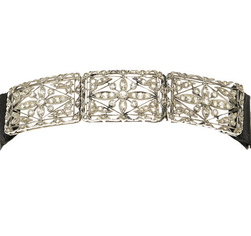 A diamond, ribbon and platinum filigree bracelet