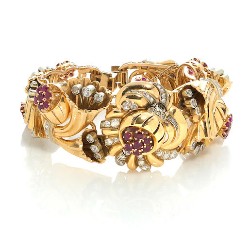 A retro ruby, diamond and eighteen karat bicolor gold covered dial bracelet wristwatch,