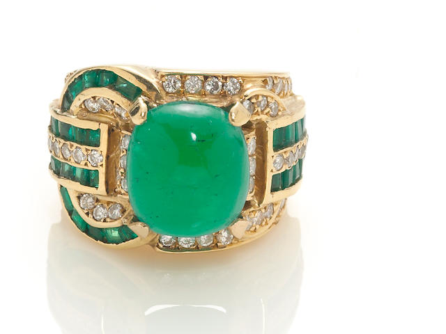 An emerald and diamond buckle motif ring