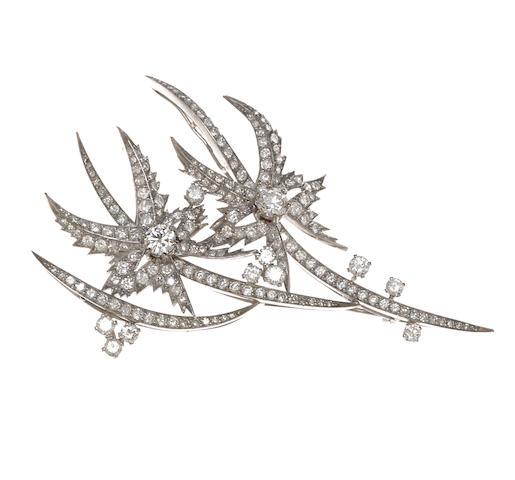 A diamond flower pendant/brooch