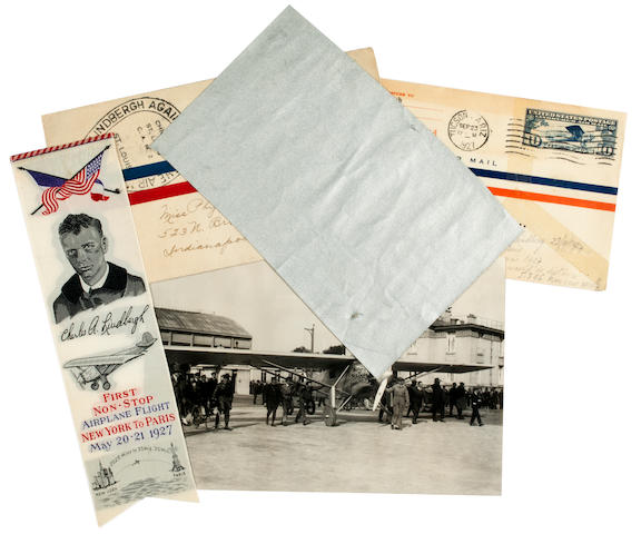LINDBERGH MEMORABILIA. 1. A square fragment of silver-coated textile, 4 x 6½ inches, believed to be from the Spirit of St. Louis.