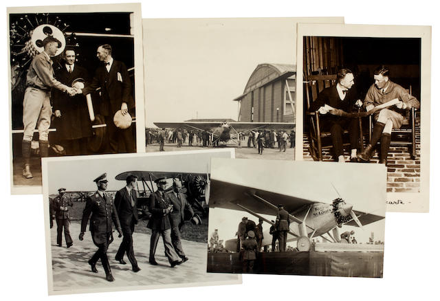 LINDBERGH PHOTOGRAPHS. Group of approximately 28 black and white photographs, various sizes, 10 x 8 inches and smaller, mostly press photographs with captions printed or pasted on verso, a little curled and dog-eared, a handful of copy prints.
