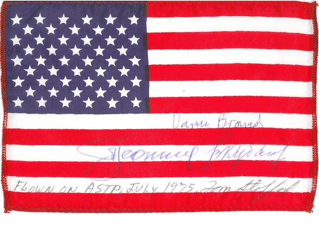 US FLAG CARRIED ON APOLLO-SOYUZ TEST PROJECT. Flown United States flag, made from silk, 4 x 6 inches.