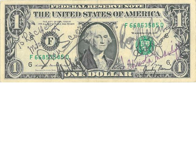 DOLLAR BILL SIGNED BY THE CHALLENGER CREW. One dollar bill, series 1981 A,