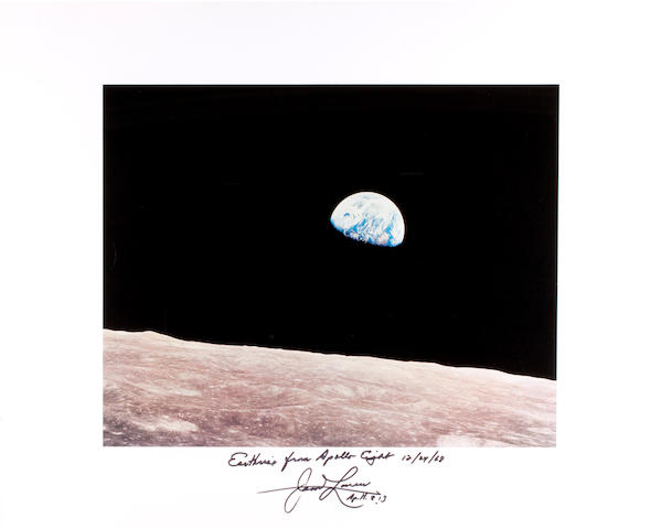 EARTHRISE. Large color photolithographed on gloss paper, 11 x 13½ inches on larger sheet. Framed.