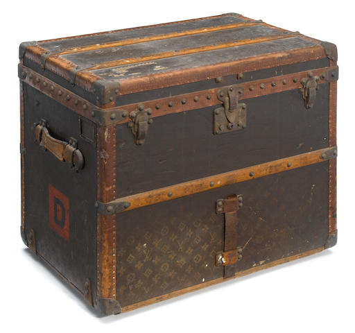 A Louis Vuitton printed canvas, enameled metal and wood trunk