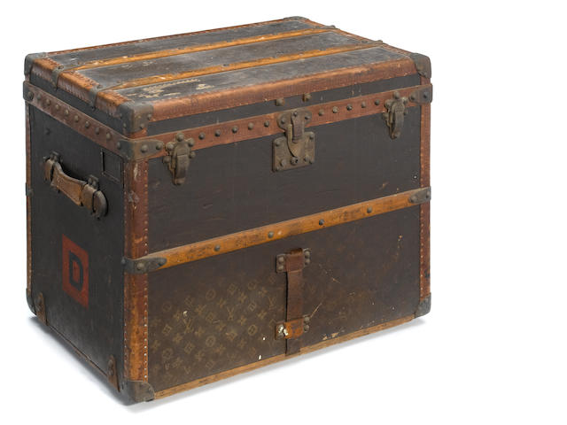 A Louis Vuitton leather clad trunk