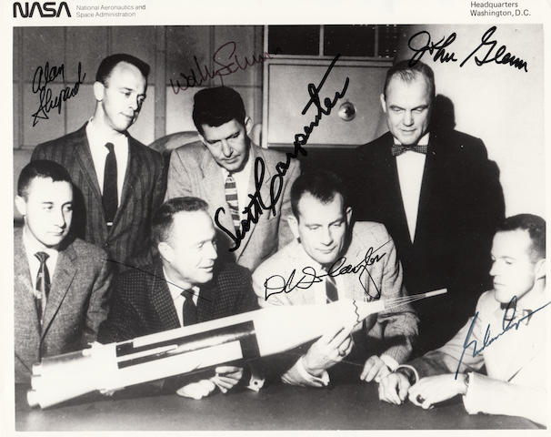 MERCURY ASTRONAUTS—SIGNED. Black and white photograph, 8 x 10 inches, with printed NASA identification information along upper border.