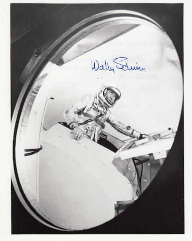 SCHIRRA TRAINING. Black and white photograph, 10 x 8 inches, printed NASA captions on verso.