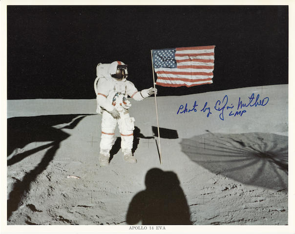 ALAN SHEPARD WITH THE UNITED STATES FLAG.  Color photolithograph, 8 x 10 inches, with NASA captions along lower border and on verso.