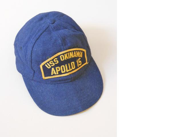 "APOLLO 15 RECOVERY SHIP BASEBALL CAP. A dark blue baseball cap with an embroidered emblem which reads: ""USS OKINAWA APOLLO 15."""
