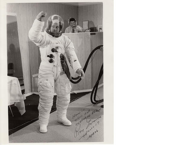 SPACE SUIT ANYONE? Black and white photograph, 10 x 8 inches, with printed NASA text on verso.