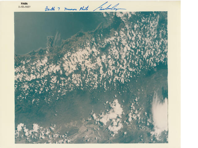 COOPER—PHOTOGRAPHER IN ORBIT. Color photograph, 8 x 10 inches, with a NASA ID number at the upper border and printed NASA captions on verso.